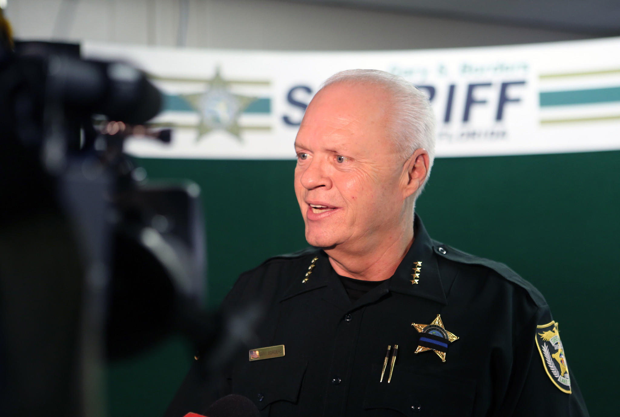 Sheriff Gary Borders answers questions during a press conference in Tavares, on Wednesday, February 12, 2014. Lake County Sheriff's cyber crime detectives arrested more than 20 suspects during an undercover sting operation in Clermont.