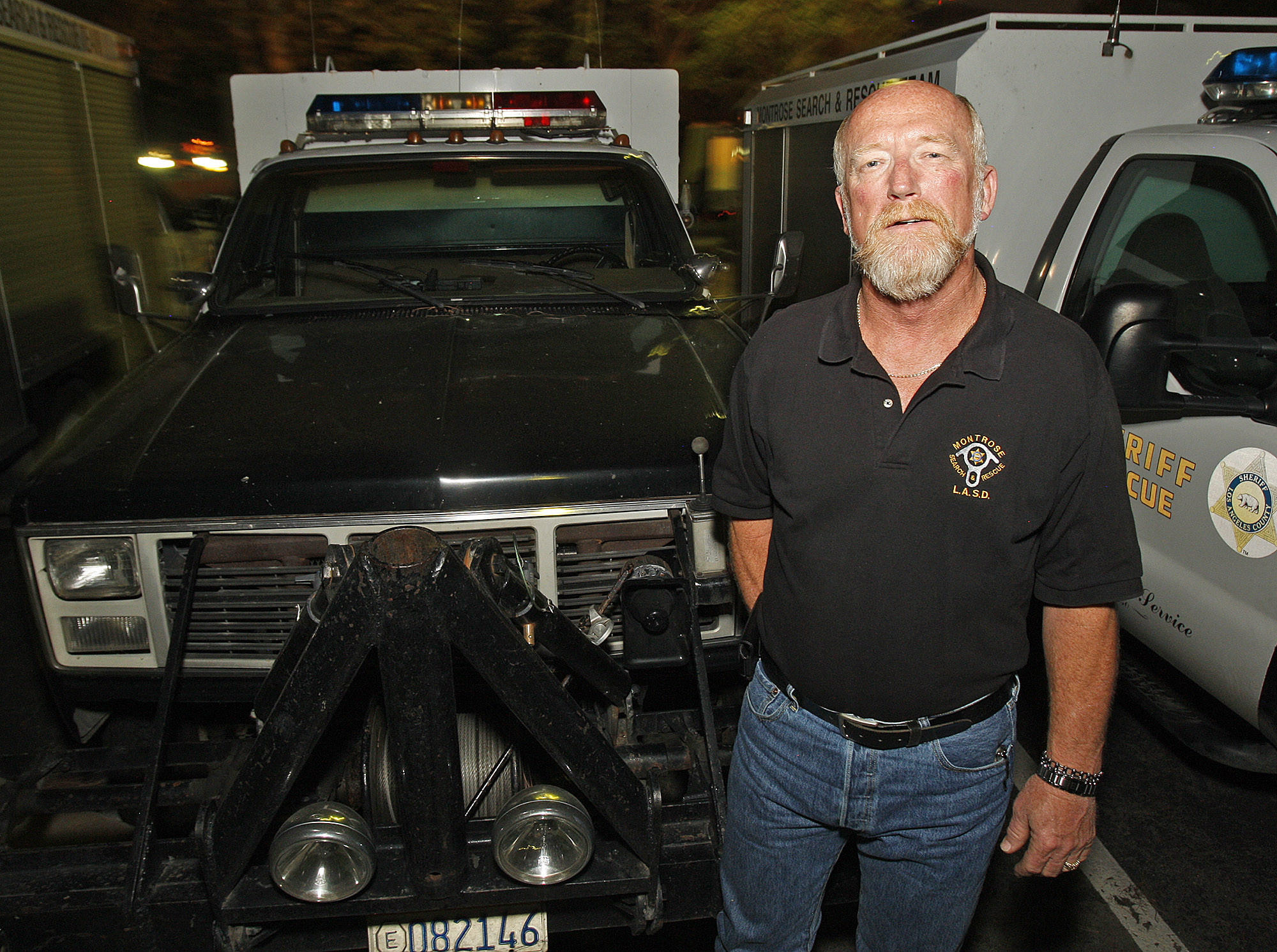 Jerry Hill stands in front of one of the Montrose Search and Rescue team patrol vehicles in La Crescenta on Tuesday, February 11, 2014. Hill recently retired after 34 years as a volunteer with the team.