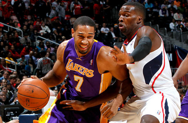 Lakers swingman Xavier Henry, driving against Hawks guard Shelvin Mack, earlier this season, is still a month away from being able to play.