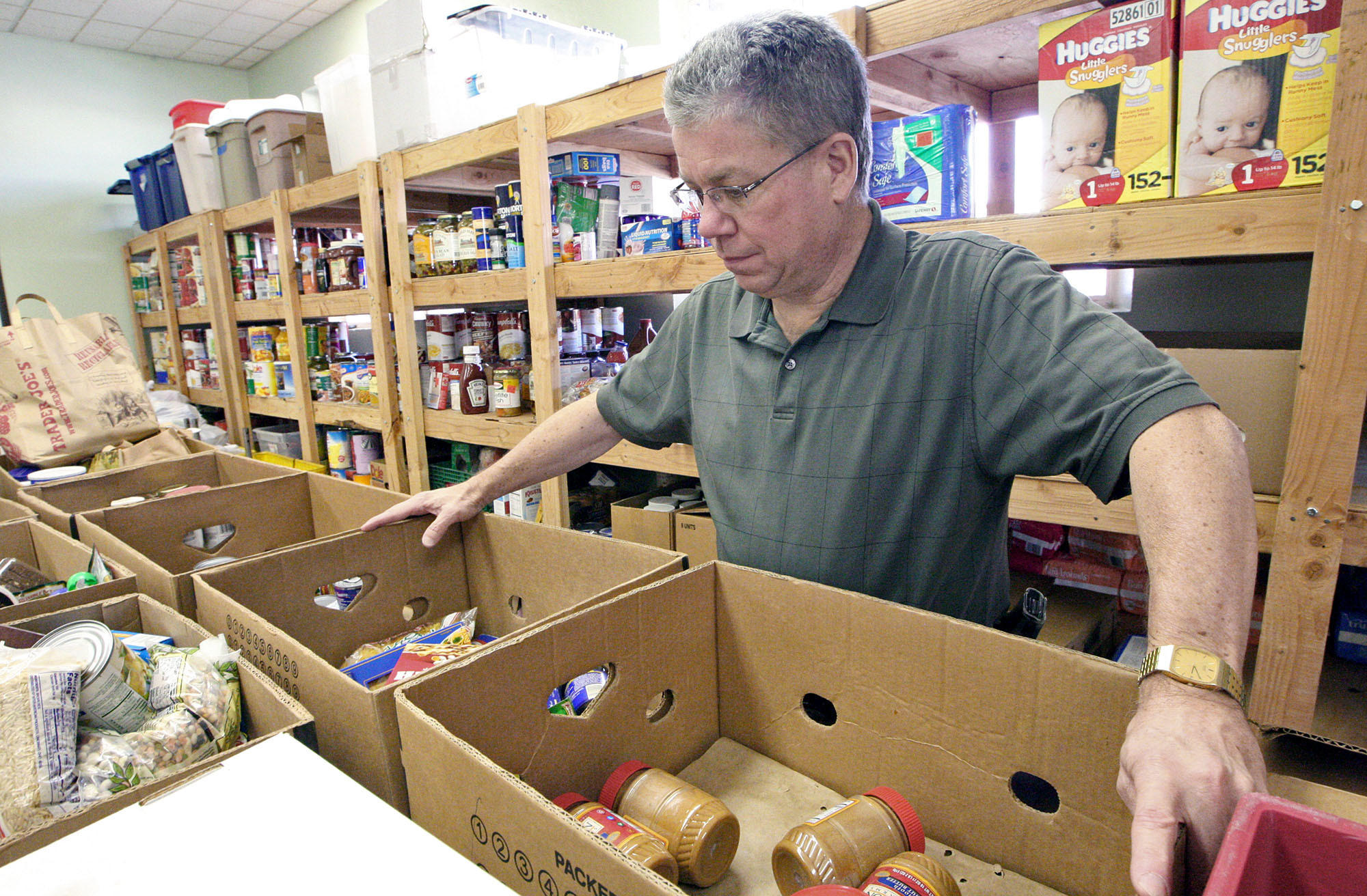 Rick White with the Salvation Army looks over the group's food stocks for their food assistance program on Wednesday, Feb. 12, 2014.