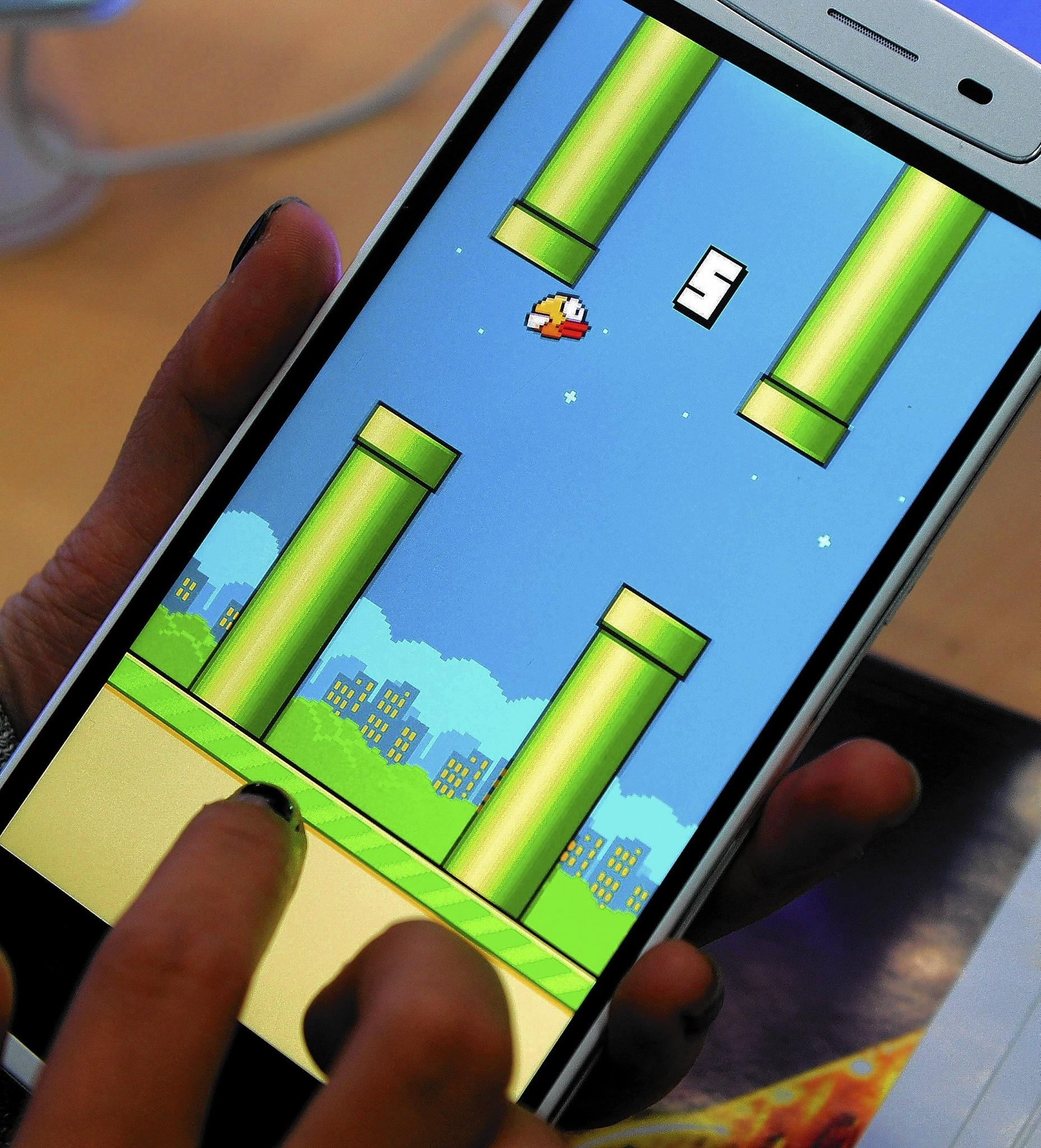 """The Vietnamese developer behind the smash-hit free game Flappy Bird has pulled his creation from online stores after announcing that its runaway success had ruined his """"simple life."""""""