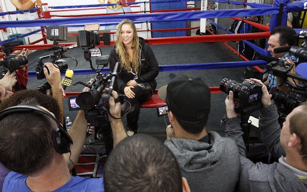 Ronda Rousey is interviewed at an open workout with the MMA champion at the Glendale Fighting Club in Glendale on Monday, February 10, 2014. (Tim Berger/Staff Photographer)
