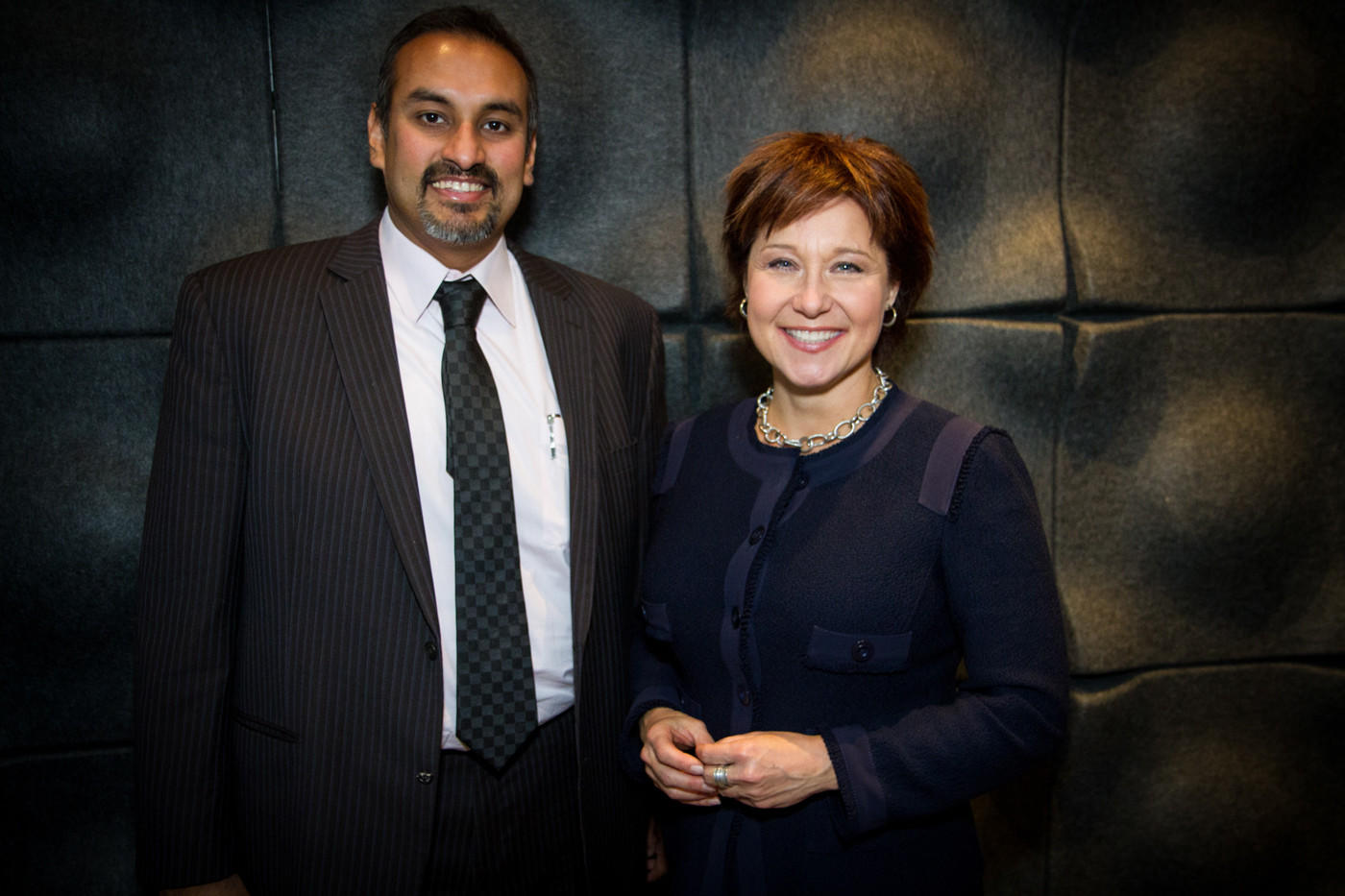 Namit Malhotra, chief executive and founder of Prime Focus World, stands alongside British Columbia Premier Christy Clark in the company's Los Angeles facility.