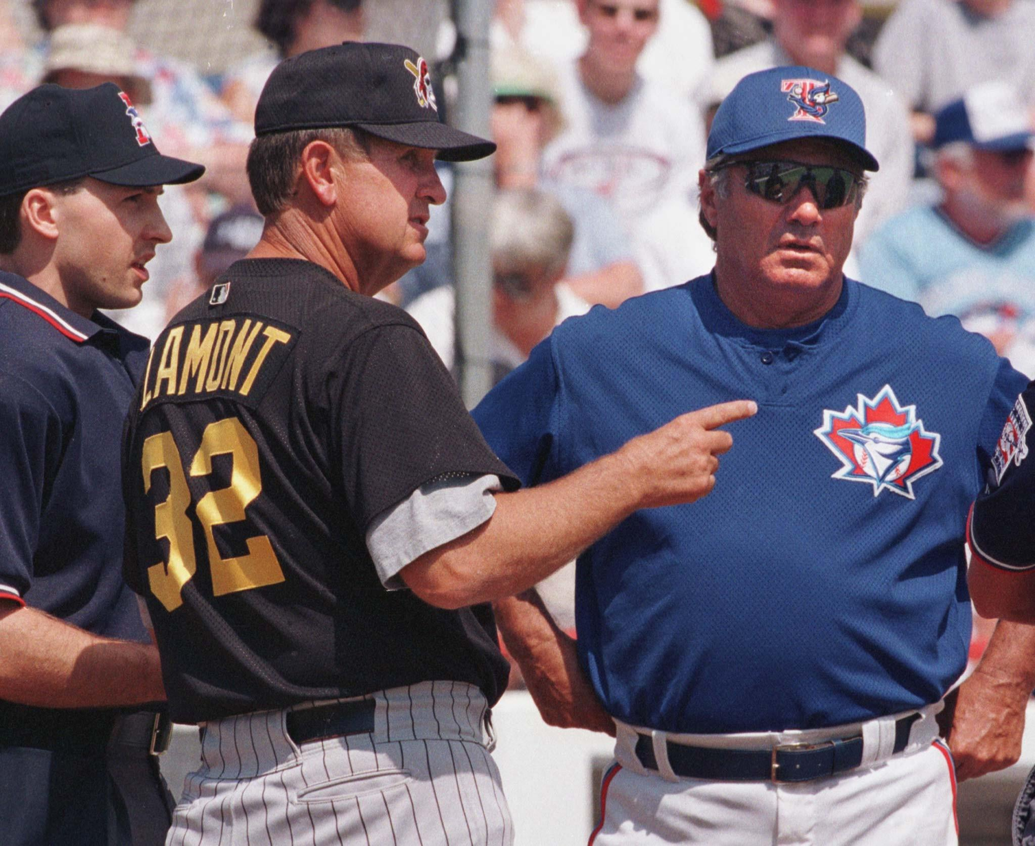 Umpire Pat Spieler (left) looks on as Pittsburgh Pirates manager Gene Lamont and Toronto Blue Jays manager Jim Fregosi meet at home plate before an exhibition game in 2000.