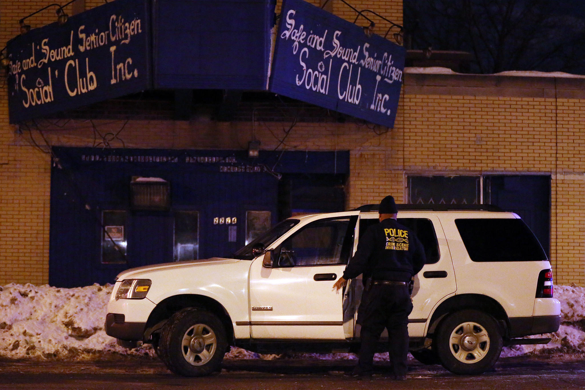 A Gary police officer leaves a crime scene after reports of a shooting at the Safe and Sound Senior Citizen Social Club in the 2000 block of South Broadway Avenue in Gary, Ind.