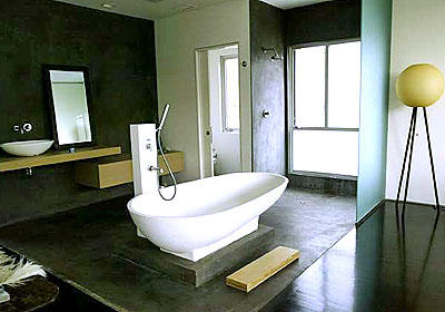 The starkly designed master bath at Jai House features a tub from Italy and an open shower.