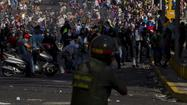 Venezuela protests turn deadly; Maduro accuses opponents of coup plot