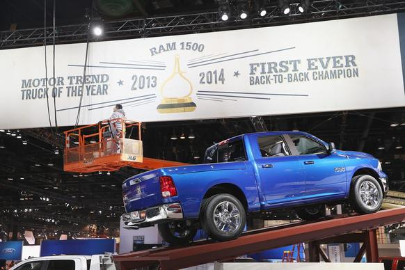 A worker helps to prepare the Ram truck exhibit at the 2014 Chicago Auto Show.