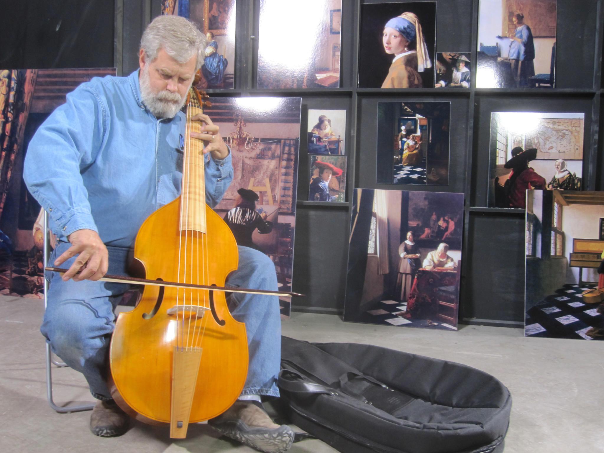 "In his warehouse in San Antonio, Texas, Tim Jenison plays the viola de gamba he used to furnish his Vermeer room in the film ""Tim's Vermeer."""