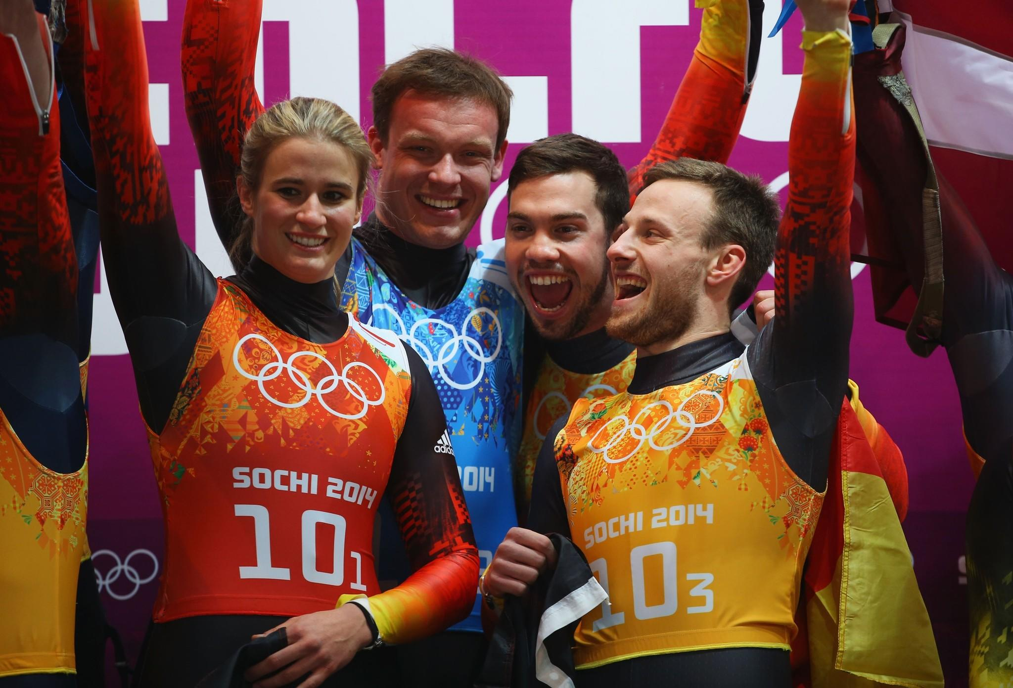 Gold medalists (from left) Natalie Geisenberger, Felix Loch, Tobias Wendl and Tobias Arlt of Germany celebrate after the Luge Relay.