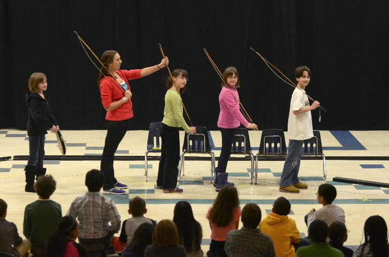 "During a rehearsal of ""The Fisherman and His Wife"" at Smith STEM School in West Hartford, Smith students Olive Kolentus, 10, (from left), Children's Stage Adventures team narrator Melissa Buriak, 23, Ruth Dunlap, 9, Emily Steadman, 9, and Luke Dunlap, 9, sing ""Fisherman's Life For Me"". The show was cast on Monday and will be performed on Friday. Children's Stage Adventures (CSA) is in the middle of a week-long residency at Smith STEM school, producing a musical ""The Fisherman & His Wife,"" which involves about 75 students."
