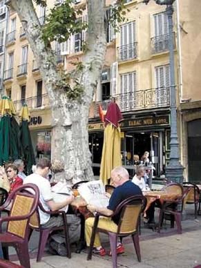 The Place de l'Hotel de Ville is a favorite gathering spot for tourists, locals and students in cosmopolitan Aix-en-Provence, France.