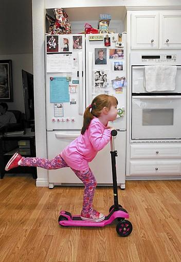 Emily Phillips scoots around the family kitchen in her Aliso Viejo home on a recent afternoon. Laguna Beach Unified is reflecting national trends that reveal an increase in numbers of children with autism.