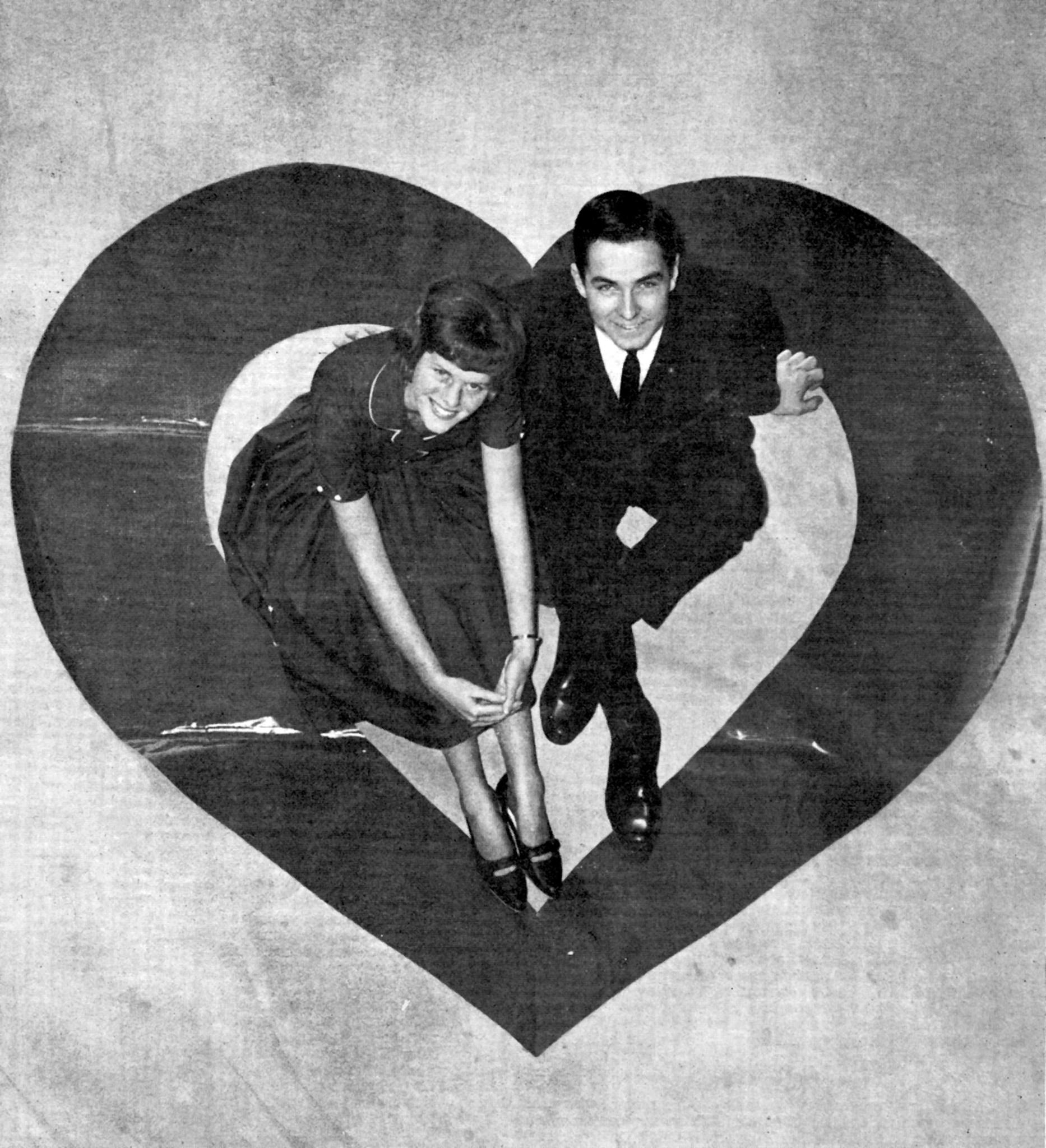 La Cañada High School students Ellie Annan and Dale Lepper pose on a vinyl heart to publicize in the Valley Sun that the newly-opened school would hold its first Valentine's Day dance in February 1964.