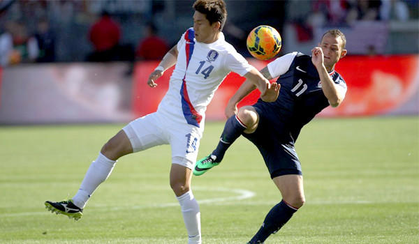The United States' Brad Davis, right, keeps the ball away from South Korea's Lee Yong during a Feb. 1 friendly match at StubHub Center. The U.S. defeated South Korea, 2-0.