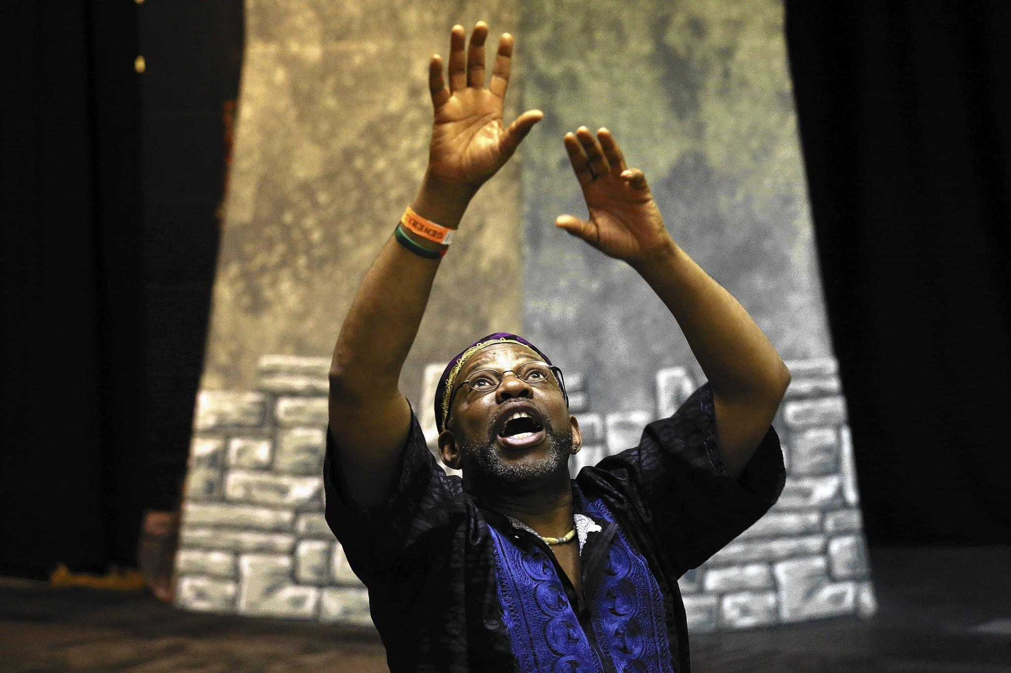 Oba William King uses a drum, emotive facial expressions and the African tradition of call and response to tell stories to children in Chicago on Feb. 2.