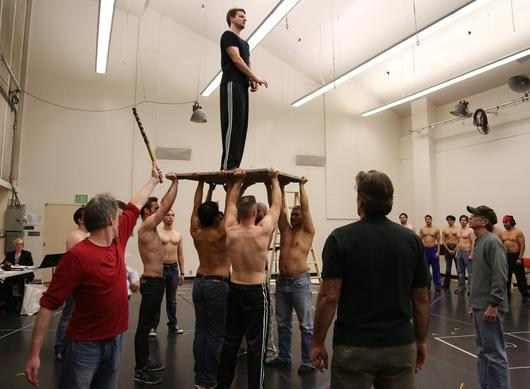 "Actors practice lifting Liam Bonner, who plays the title role, during a rehearsal of Los Angeles Opera's ""Billy Budd"" at the Dorothy Chandler Pavilion in Los Angeles."