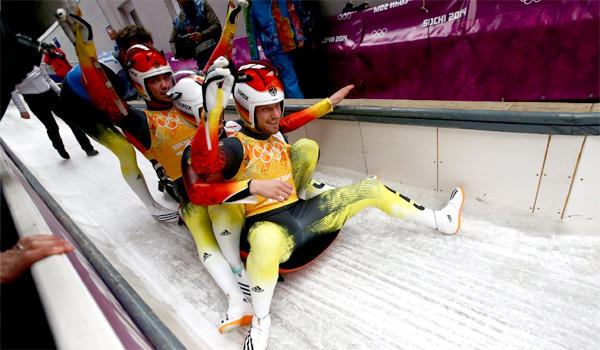 Felix Loch, Tobias Wendl, Natalie Geisenberger and Tobias Arlt of Germany celebrate winning the inaugural luge relay event at the 2014 Sochi Winter Olympics.