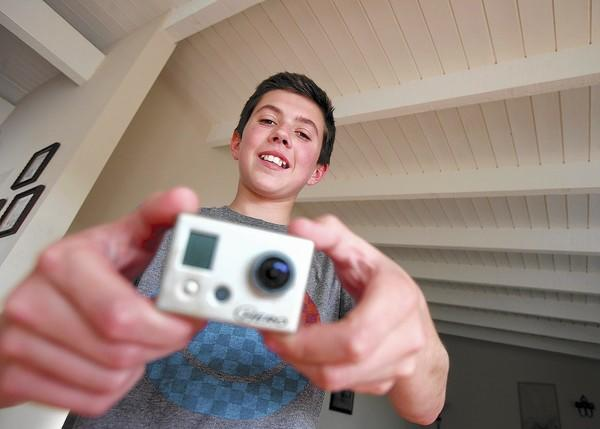 Mason Melcer, 11, happily holds the GoPro camera he lost in the ocean at Big Corona more than a year ago.