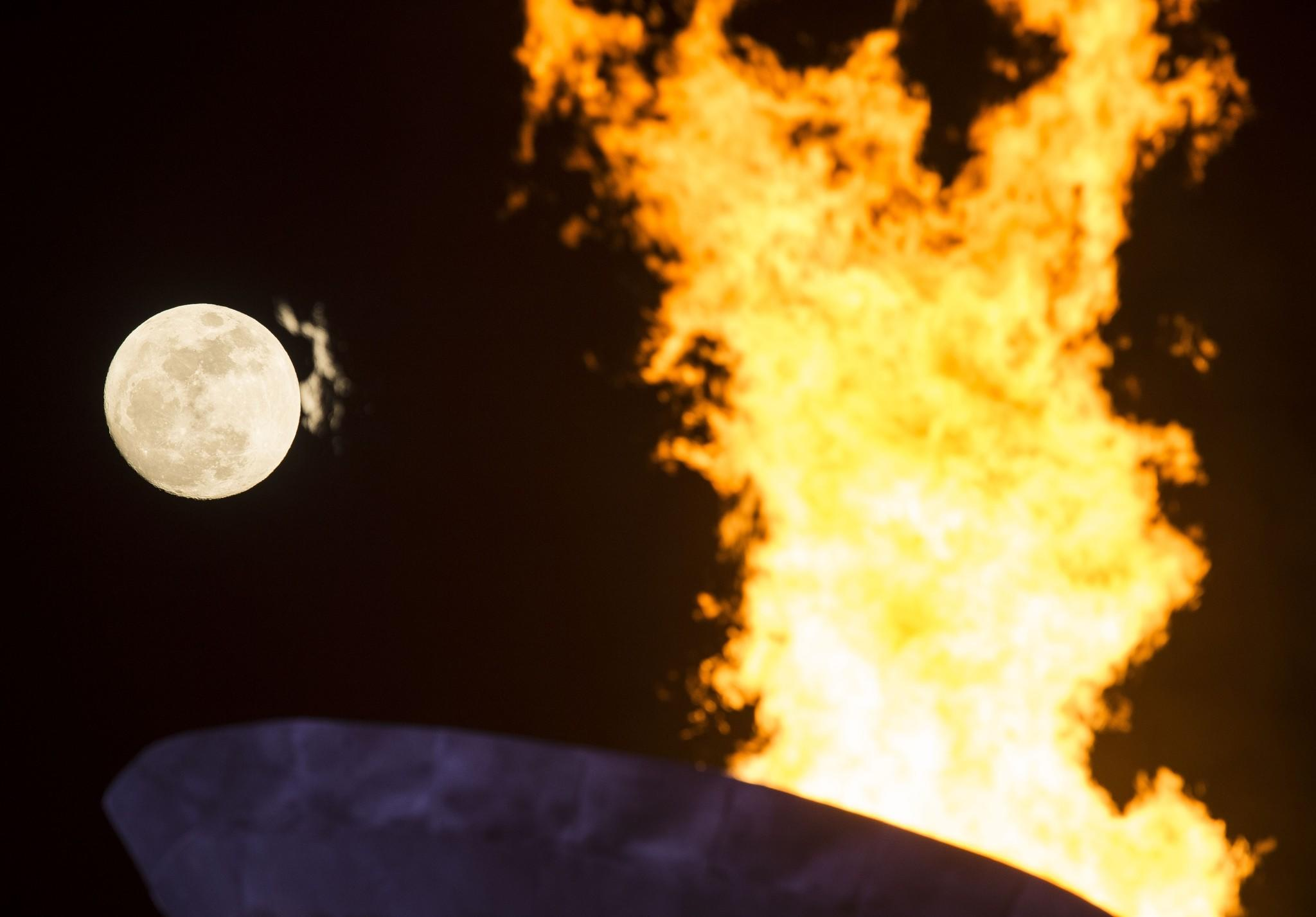 A general view of the Olympic Cauldron and flame with a full moon on day 6 of the Sochi 2014 Winter Olympics.