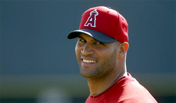 Albert Pujols reported to spring training with the Angels early, feeling good and seven pounds lighter than he was in September.