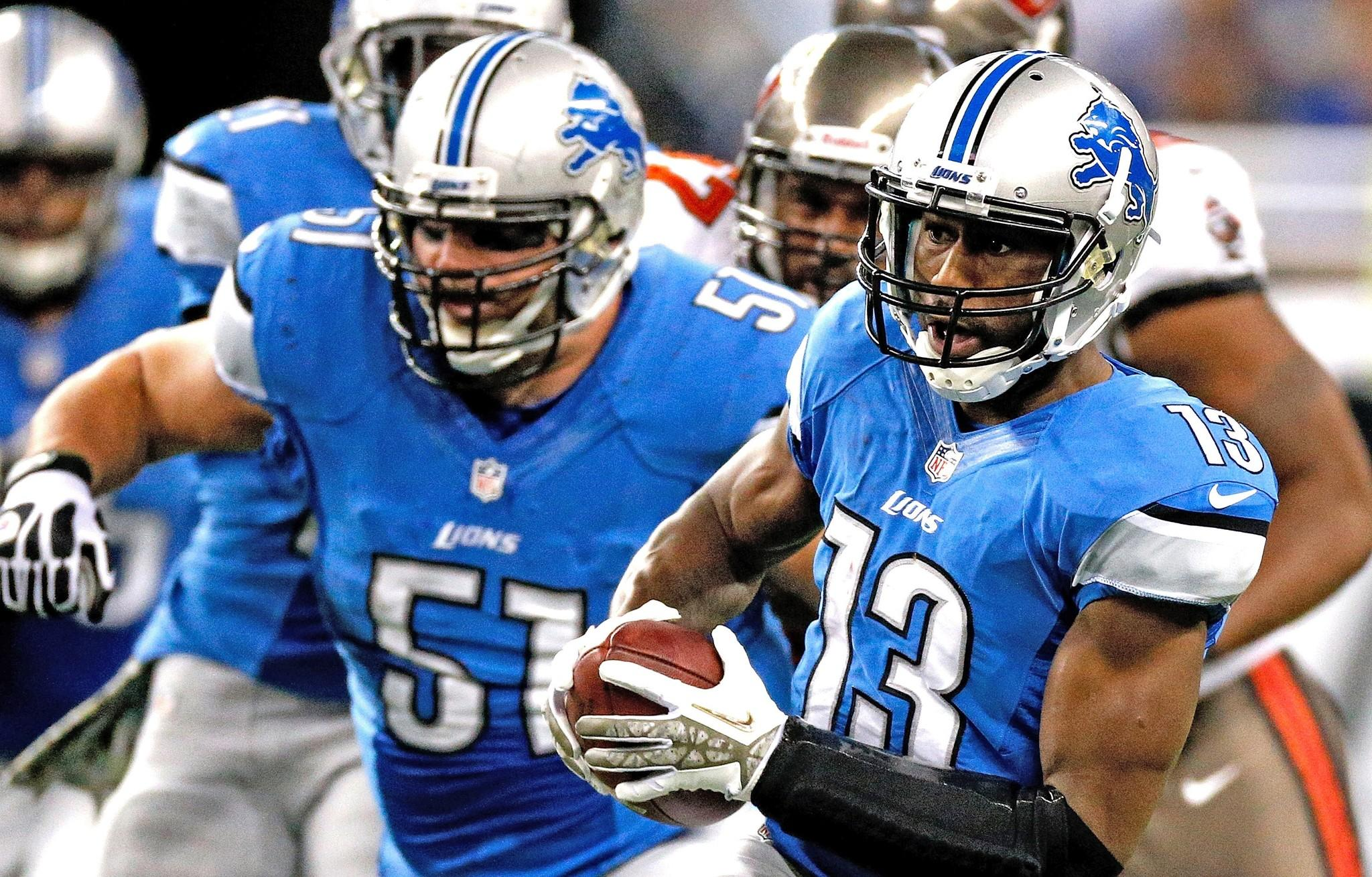 Nate Burleson heads up the field with Lions teammate Dominic against the Buccaneers.