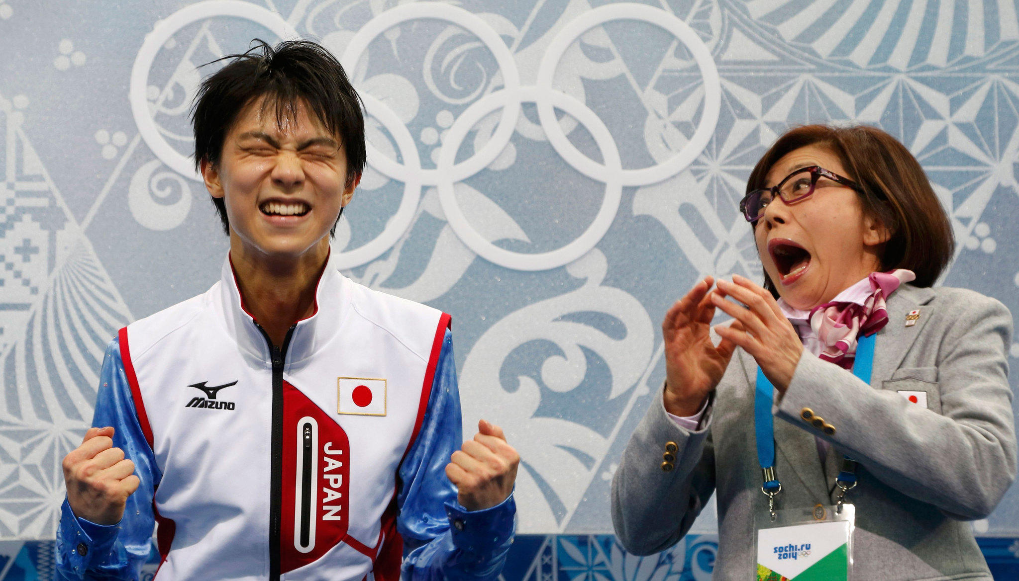 "Japan's Yuzuru Hanyu reacts with his coach Yoshiko Kobayashi in the ""kiss and cry"" area."