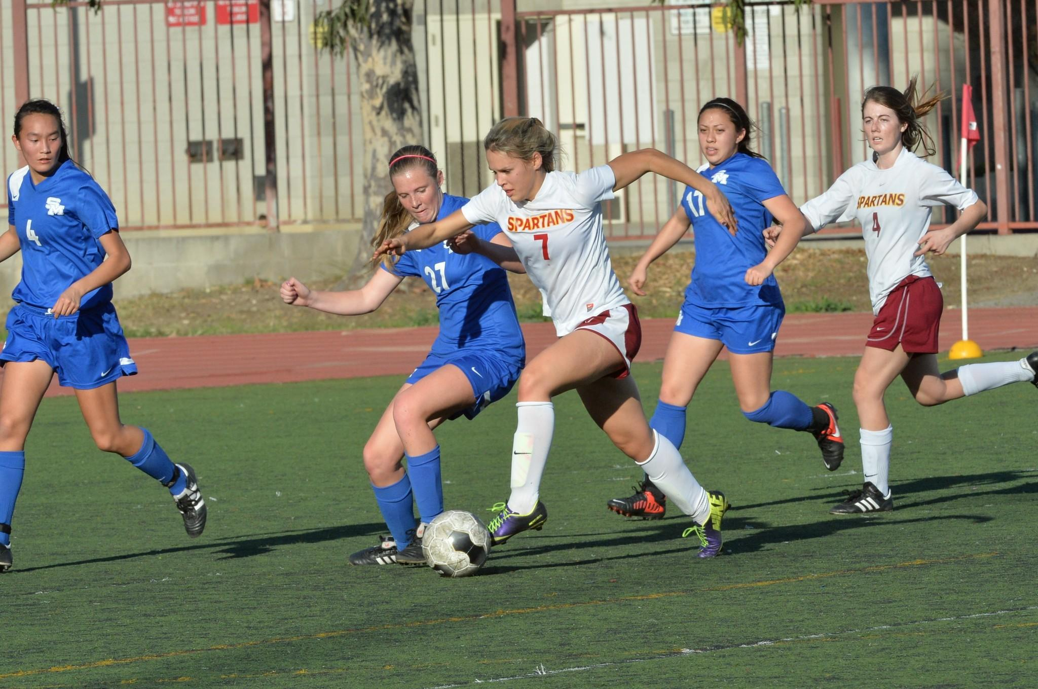 La Cañada High's Megan Decker attempts to bypass a San Marino defender during Thursday afternoon's Rio Hondo League season finale. The Spartans won, 3-1. (Photo Courtesy of Doug Brown)
