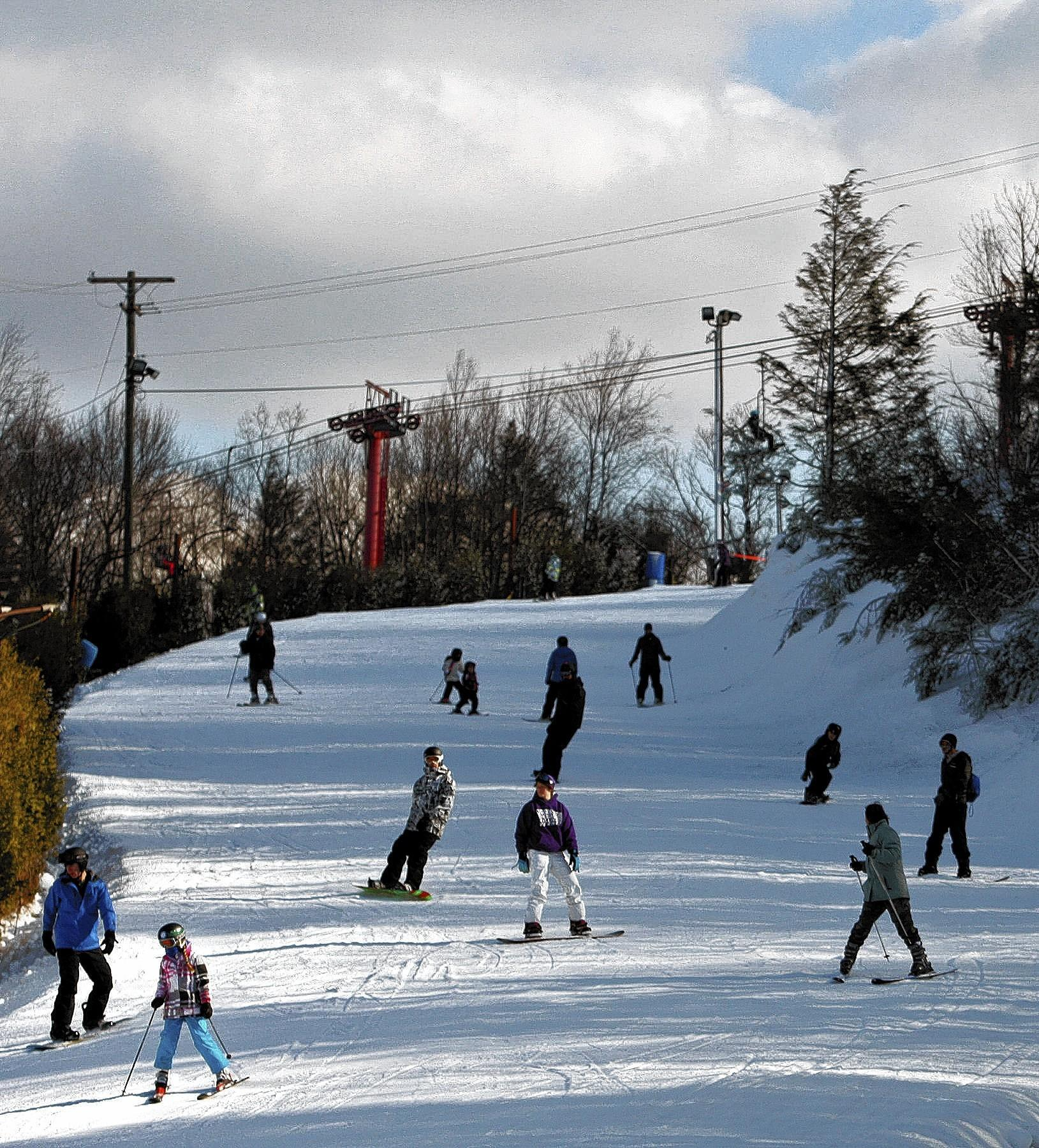 Skiers enjoy the slopes on the opening day of Blue Mountain's current season in November. Most of them had to pay, but those over 70 skied for free.