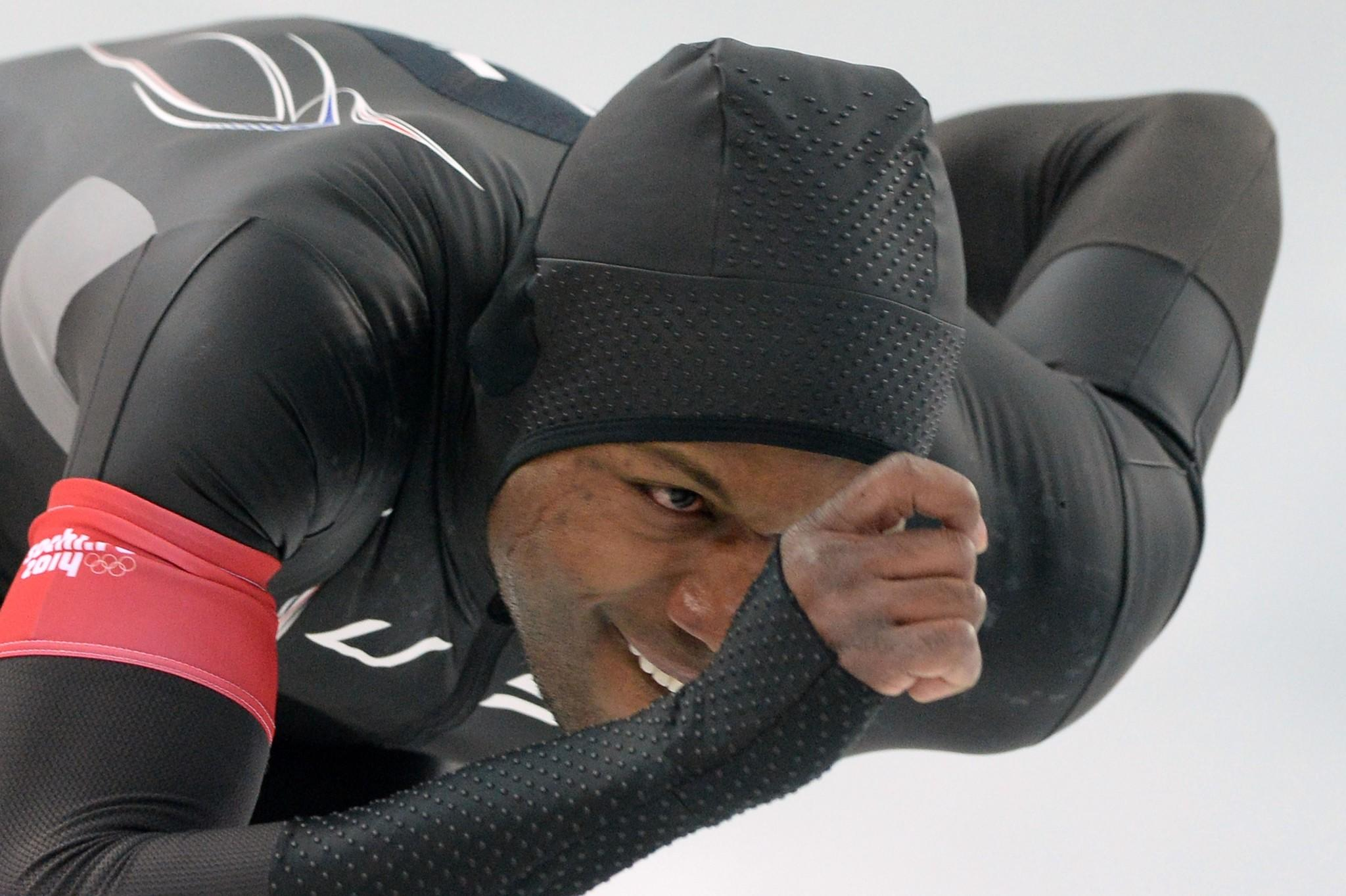 Shani Davis competes in the men's speedskating 1,000 meters at the Adler Arena during the Sochi Winter Olympics on Wednesday.