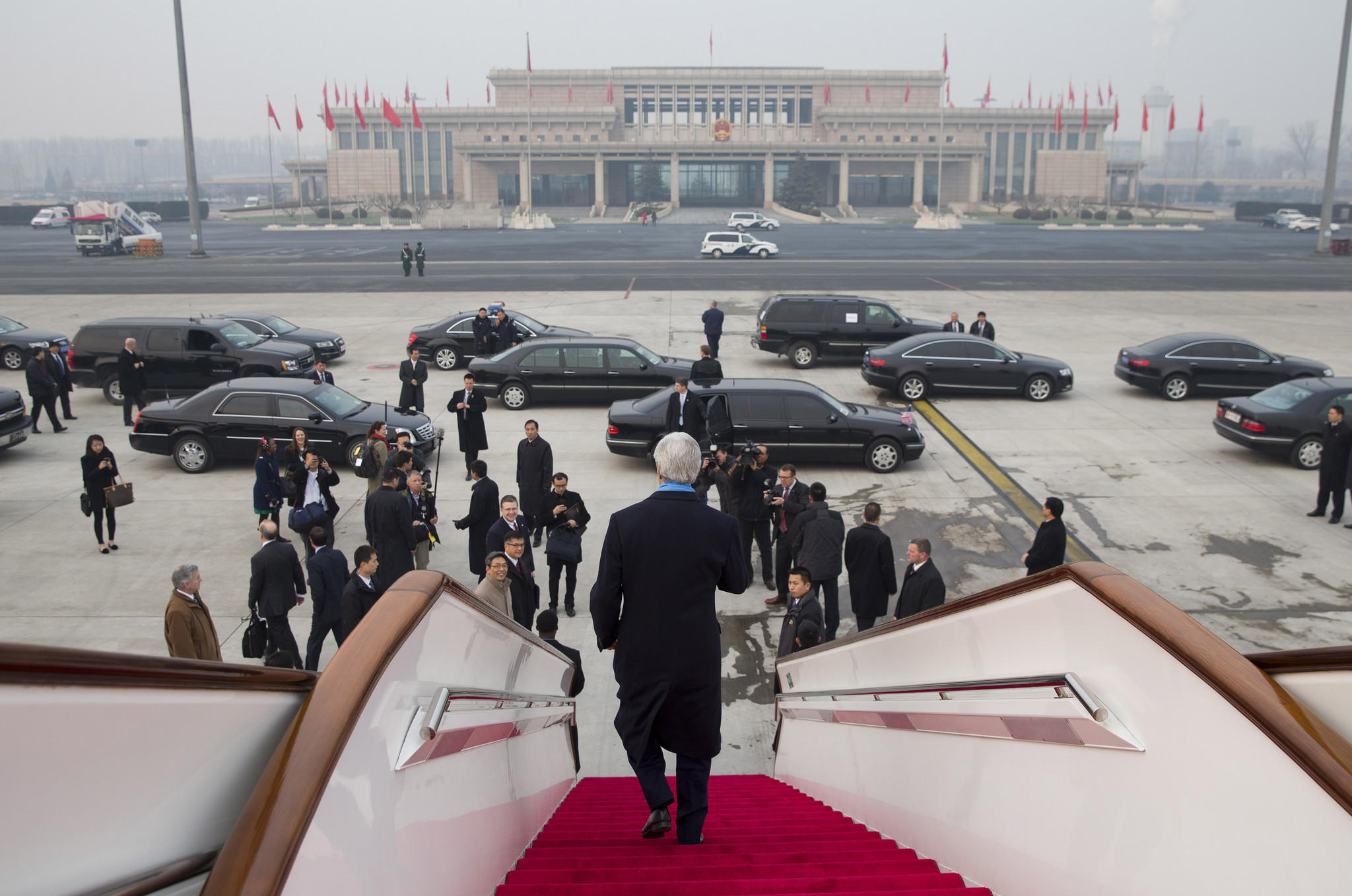 U.S. Secretary of State John F. Kerry walks off his plane after arriving at Beijing International Airport on Friday.