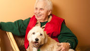 Nancy Lind, uses therapy dogs to help kids
