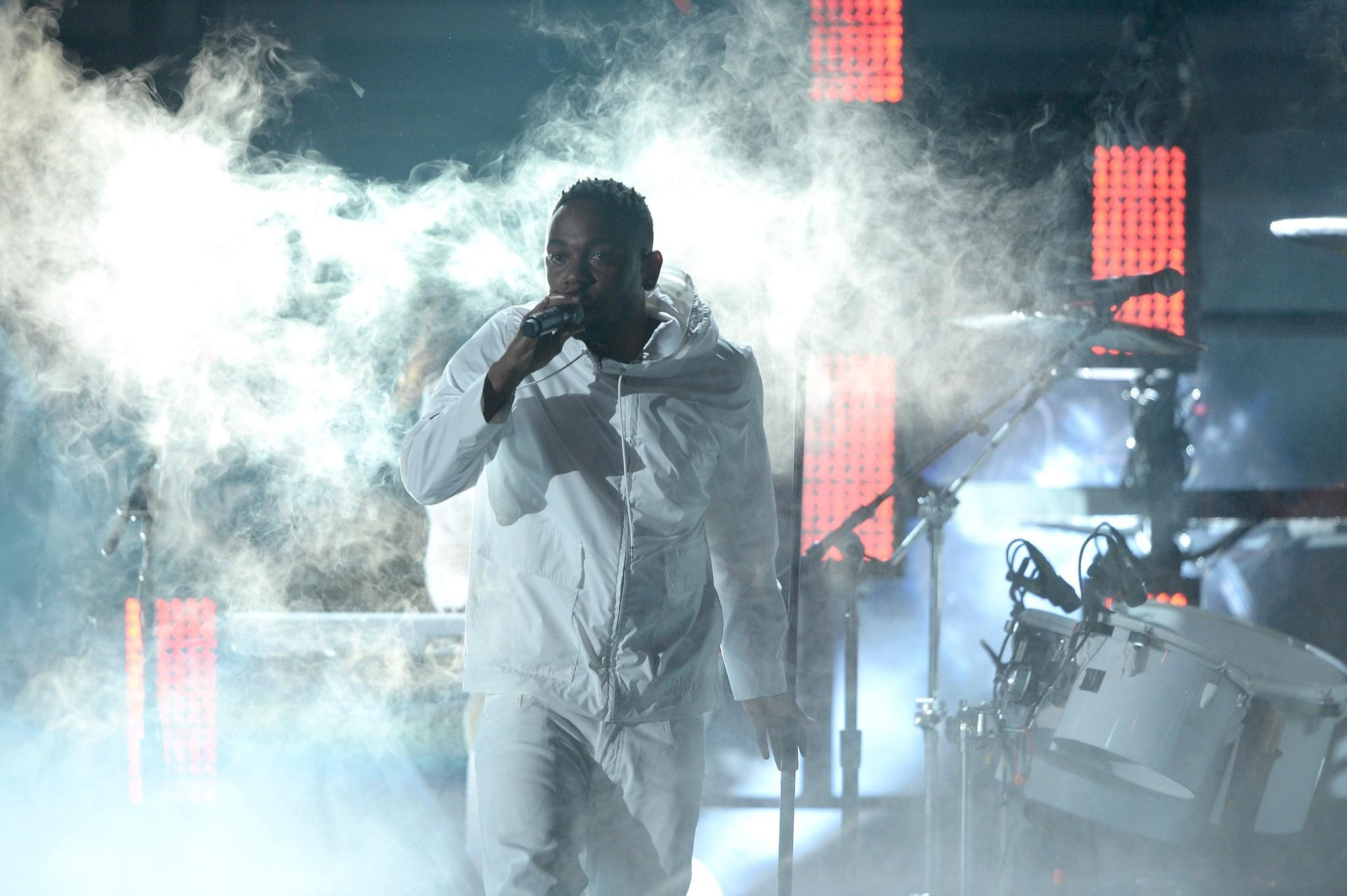 Kendrick Lamar performs onstage during the 56th Grammy Awards.