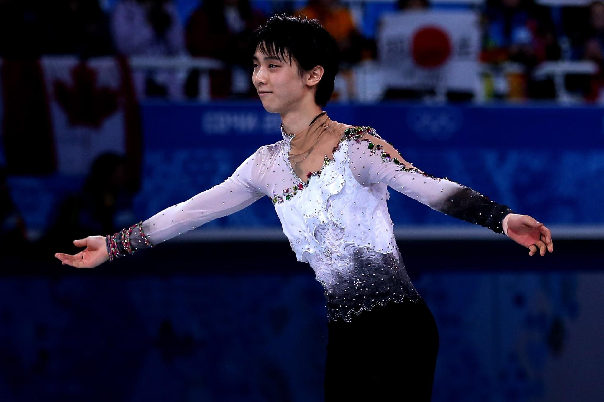 Yuzuru Hanyu of Japan celebrates after winning the gold medal Friday.