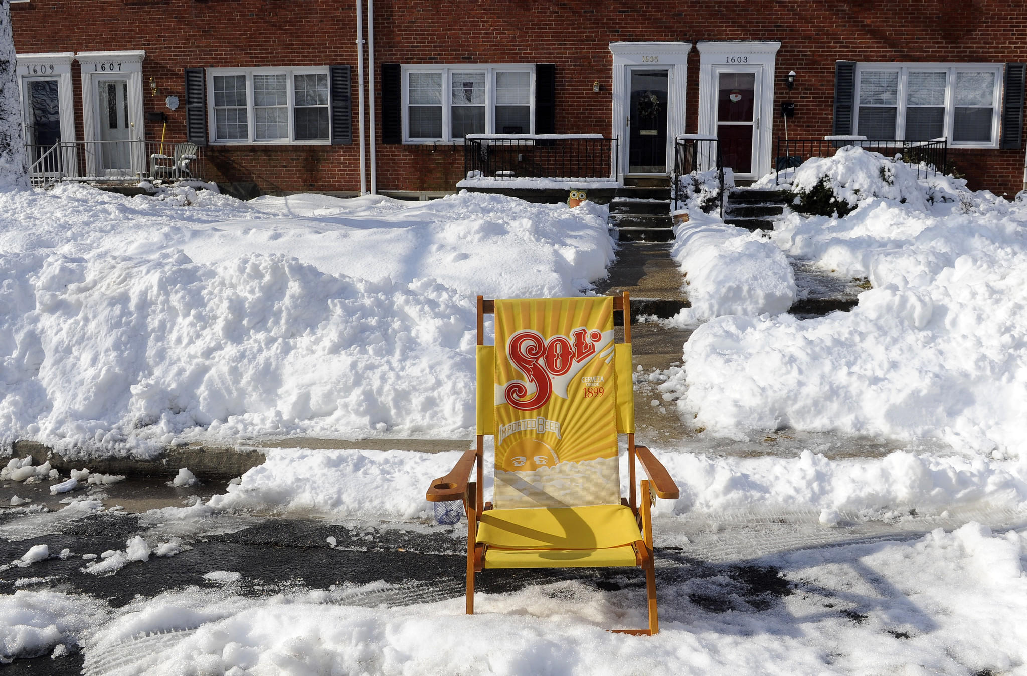 Someone in the Knettishall area of Towson used a beach chair to mark a parking space.
