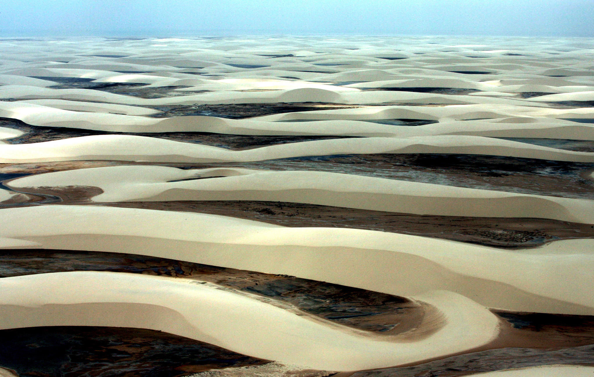 An overview of the alternating sand dunes and fresh water lakes of the Lencois Maranhenses national park, near the city of Sao Luis in northeastern Brazil.