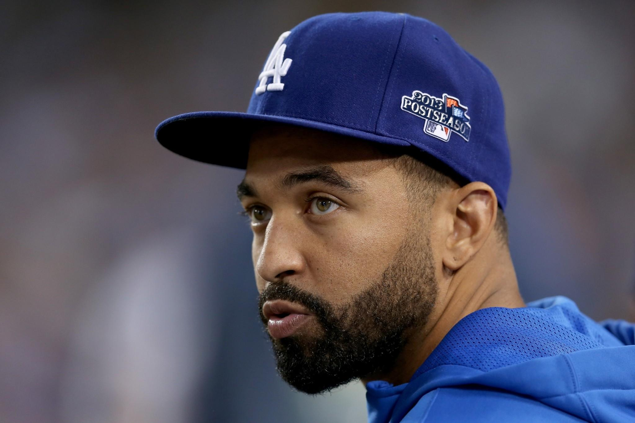 Matt Kemp looks on while the Dodgers take on the St. Louis Cardinals in Game 3 of the National League Championship Series at Dodger Stadium.
