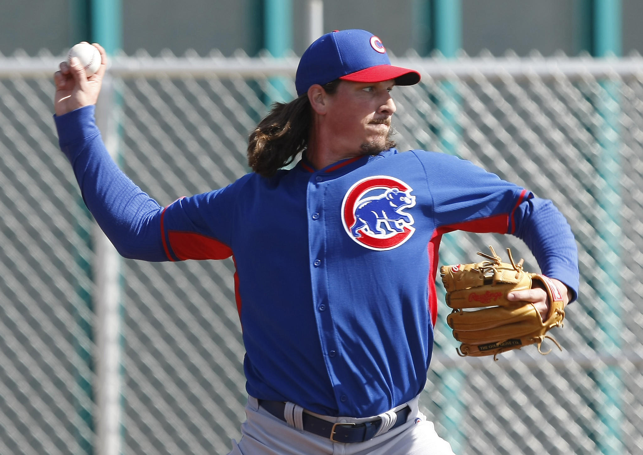 Chicago Cubs pitcher Jeff Samardzija throws out of the bullpen during spring training Friday in Mesa, Ariz.