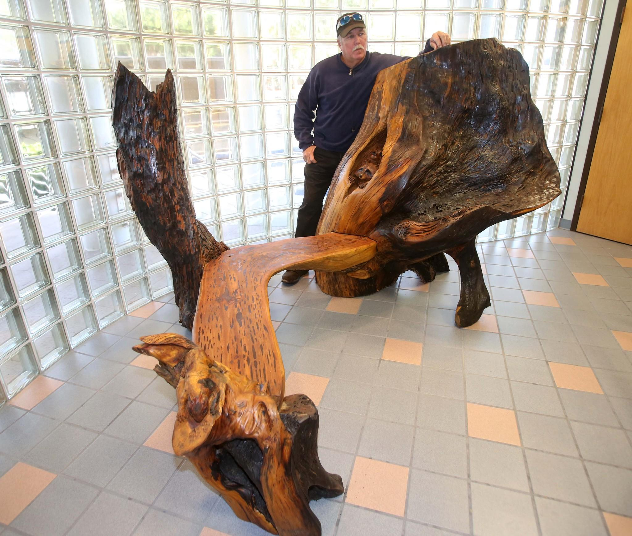 Artist Mark Rice created this bench with old wood from The Senator, an ancient cypress tree destroyed by fire. The bench is in front of the Seminole county commission chambers in Sanford.