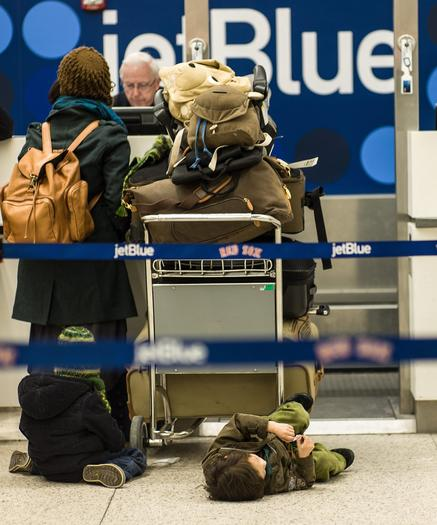 Travelers at Logan International Airport