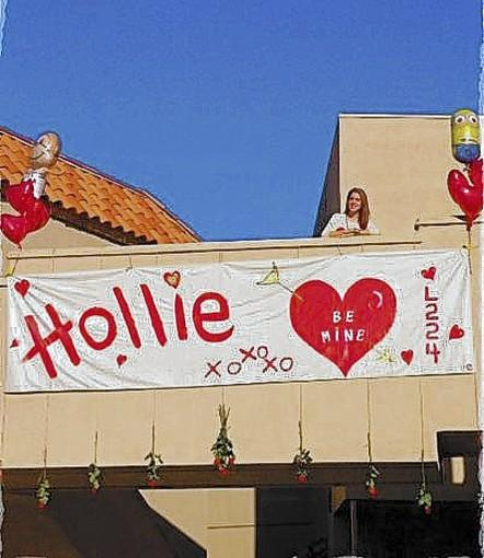 Hollie Vilander showed up to work on Valentine's Day to find a public declaration of love from her husband, Eric.