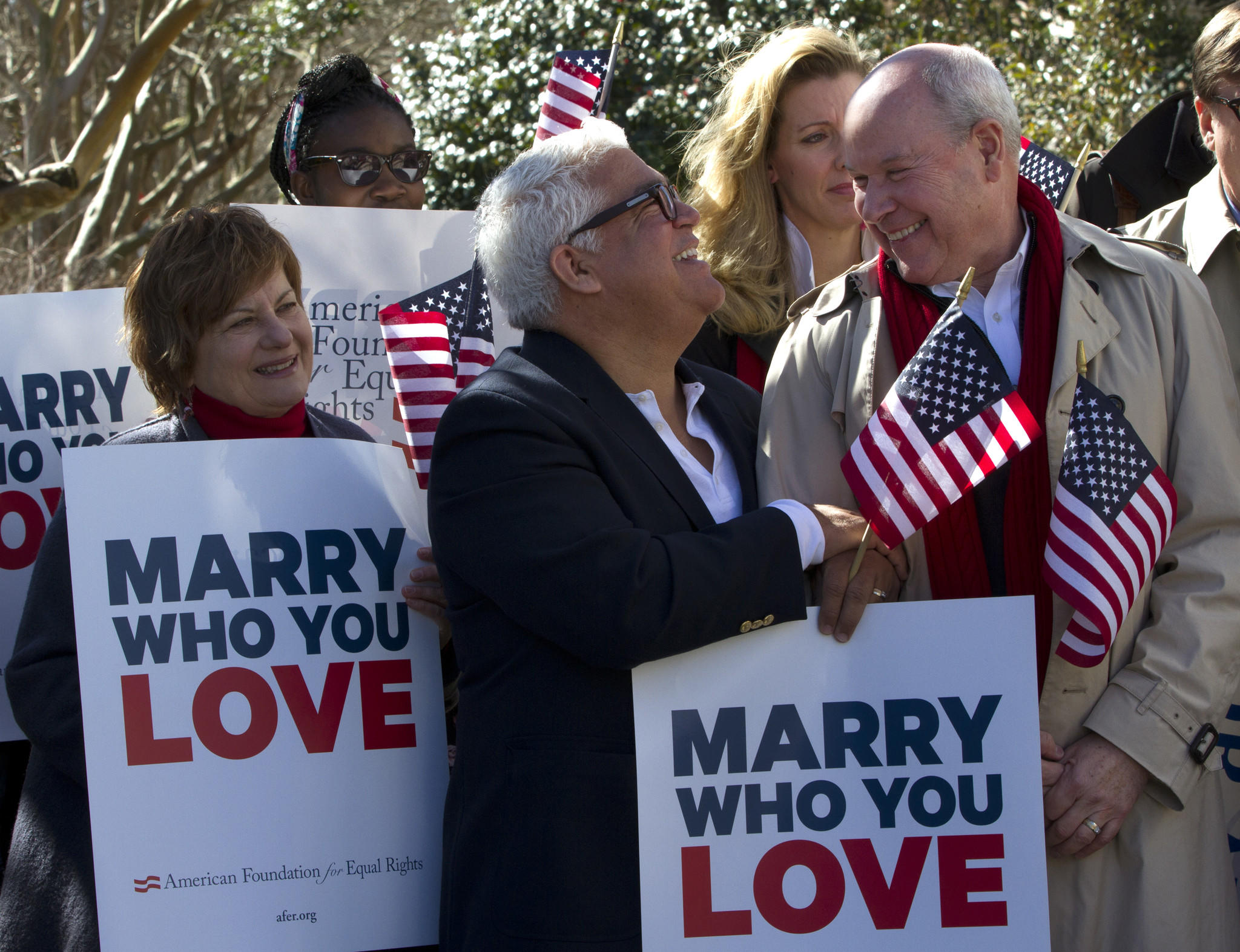 Supporters of gay marriage were ecstatic during a press conference Friday after a Norfolk Federal judge ruled the ban on gay marriage unconstitutional. The group was attending a press conference on the issue in Norfolk Friday. Shown are Cindy Cutler of Norfolk, Dominique Spencer, of Midlothian, Andria McClellan, of Norfolk, Robert Roman and Claus Ihlemann of Virginia Beach.