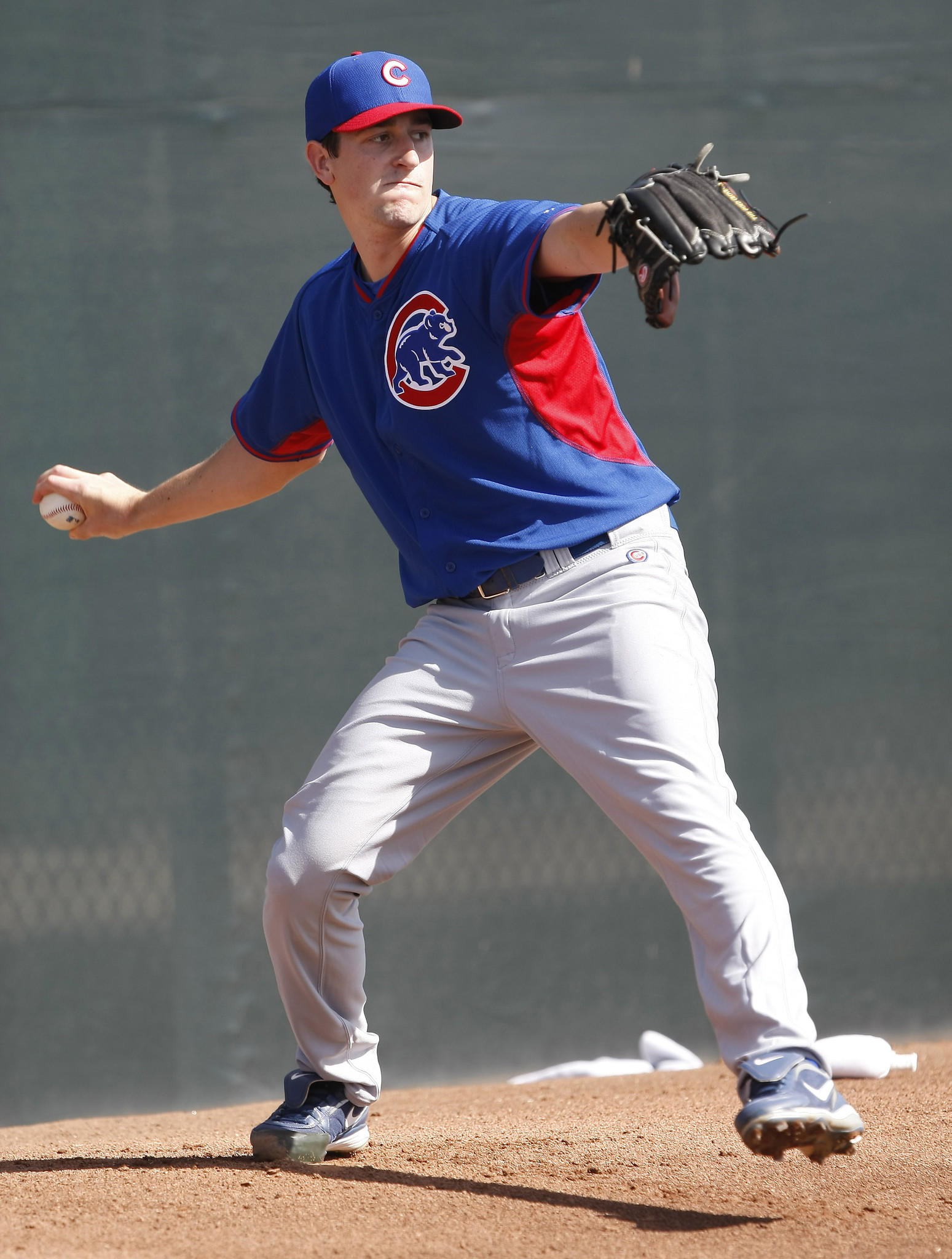 Chicago Cubs pitcher Kyle Hendricks (9) throws in the bullpen during camp at Chicago Cubs training facility at Mesa.