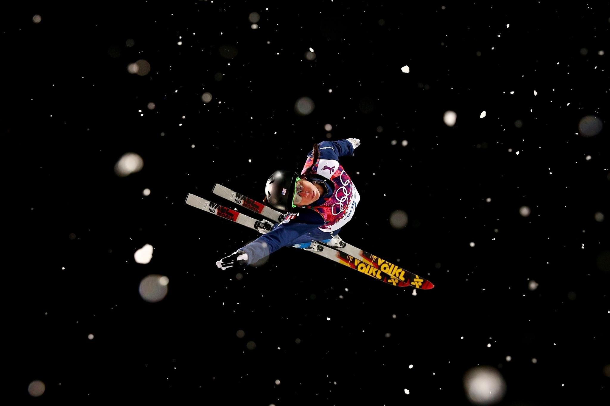 Emily Cook sails through the air during a practice run for the freestyle skiing ladies' aerials finals Friday. Cook did not advance past the first round of the finals.