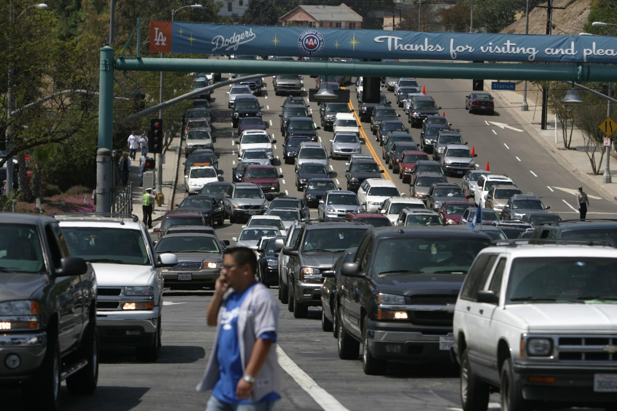 The Dodgers have raised the price of parking from $10 to $15 in an effort to reduce traffic to and from Dodger Stadium on game day.
