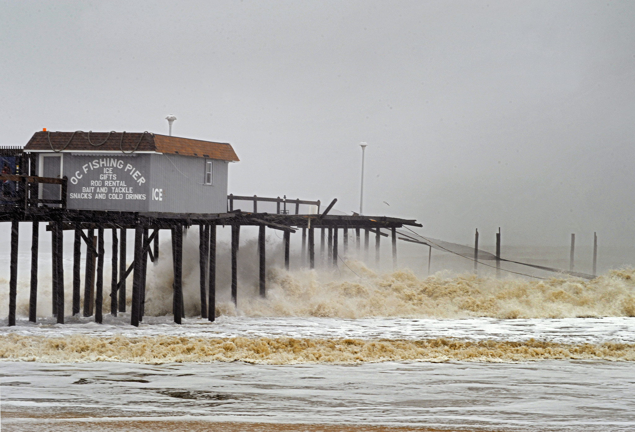 Ocean city pier damaged by winter storm baltimore sun for Oceanic fishing pier