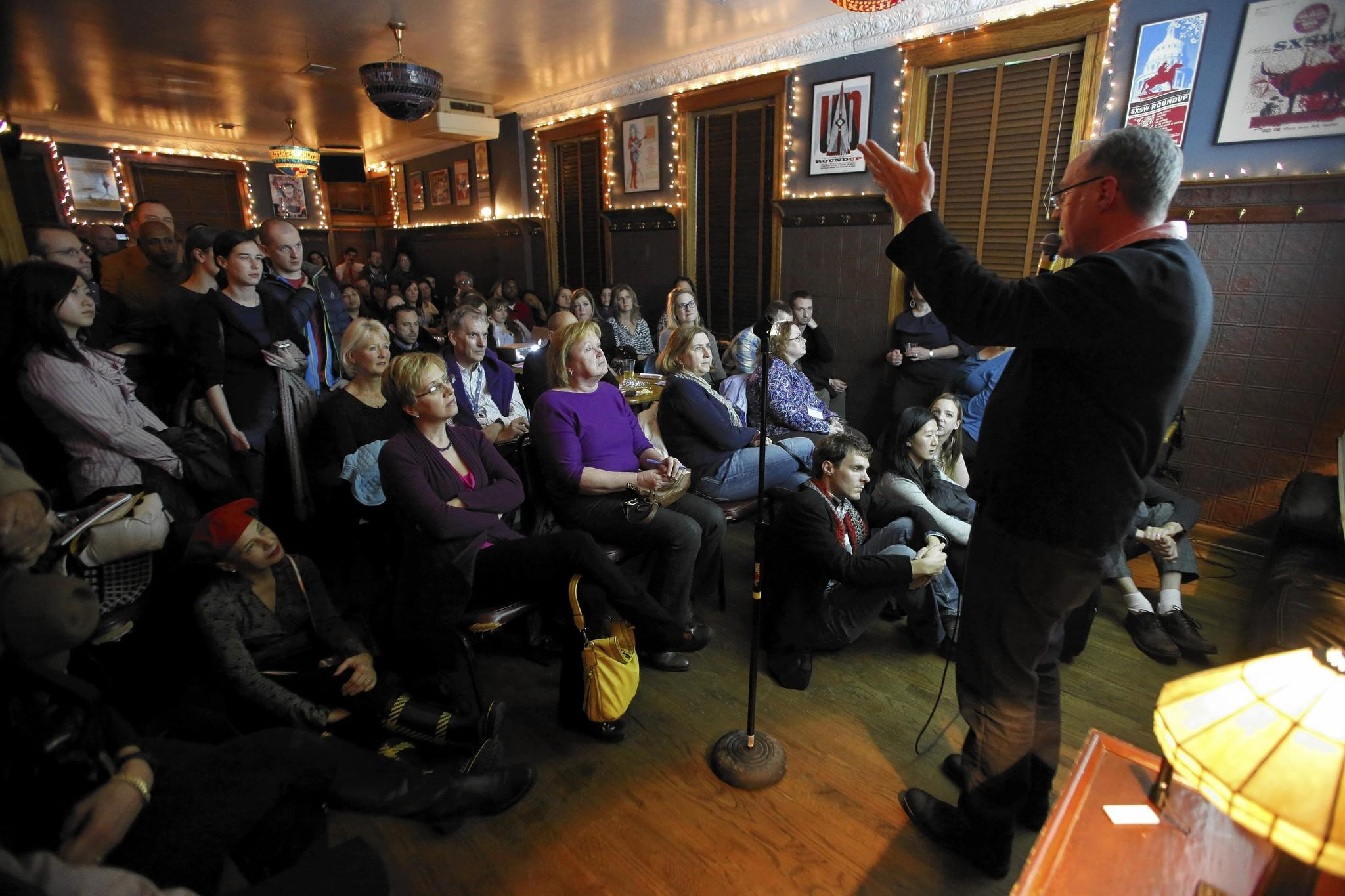"A standing-room-only crowd at Schubas Tavern listens Thursday night to Northwestern University psychology professor J. Michael Bailey during a presentation of ""The Science of Sex and Attraction."""