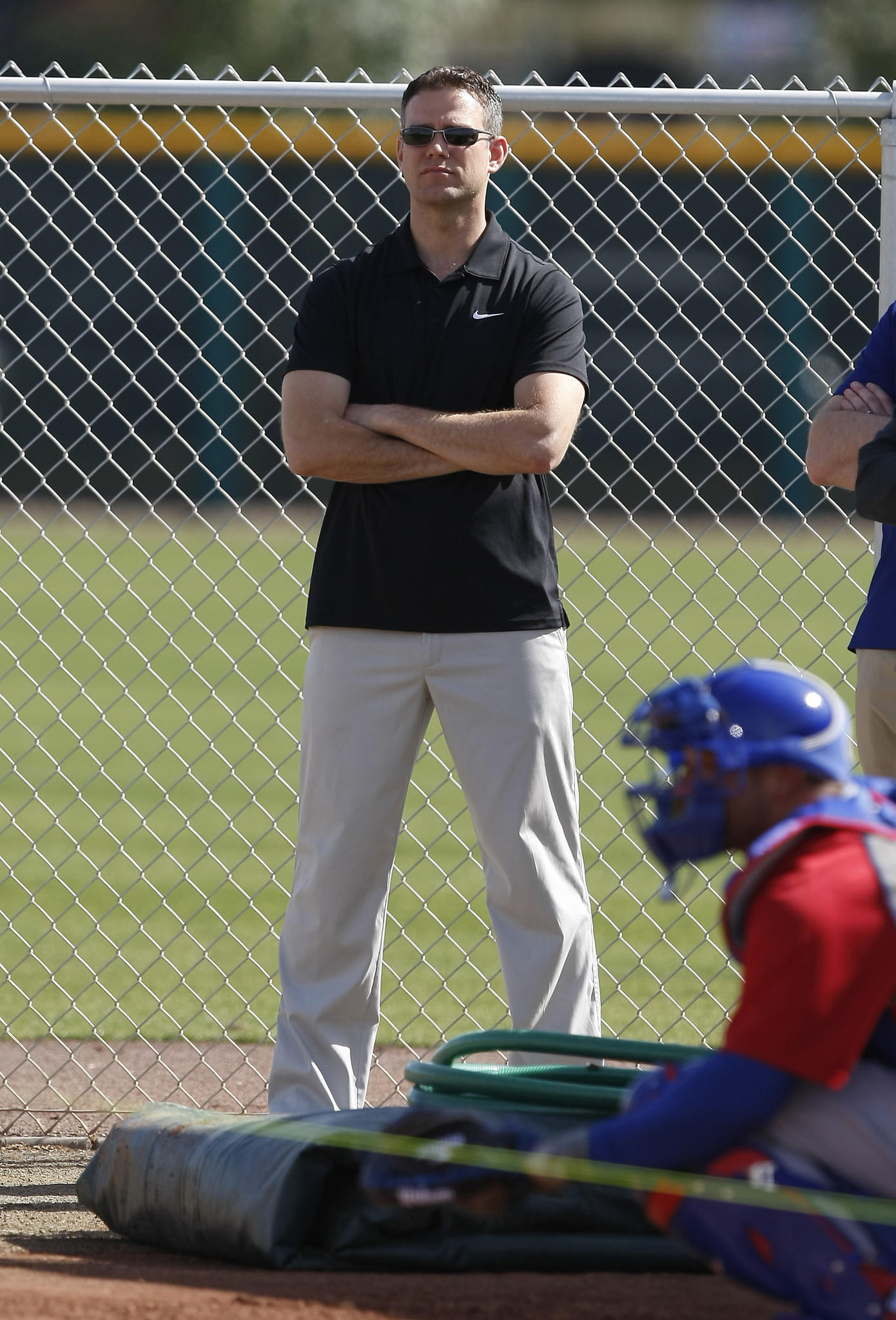 Chicago Cubs President of Baseball Operations Theo Epstein watches the bullpen during camp at Chicago Cubs training facility at Mesa.