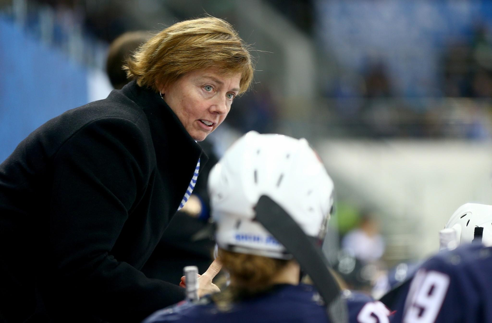 Head coach Katey Stone of the United States looks on against Canada during the Women's Ice Hockey Preliminary Round Group A game.
