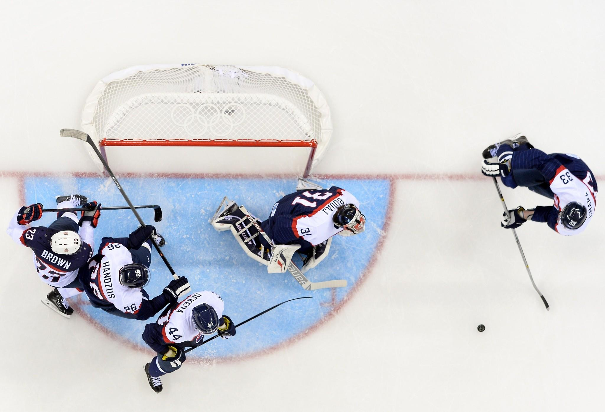 US Dustin Brown (L) challenges Slovakia's goalkeeper Peter Budaj (C), Zdeno Chara (R), Andrej Sekera and Michal Handzus (2nd-L) during the Men's Ice Hockey Group A match between Slovakia and the United States.